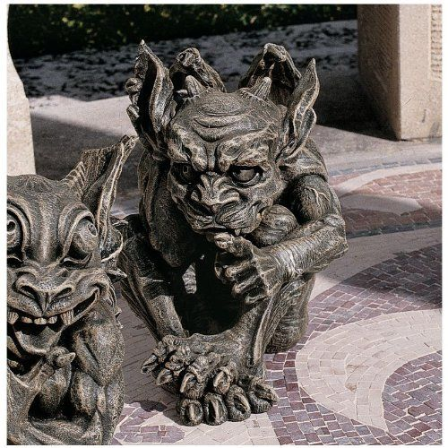 Whisper The Gothic Gargoyle Statue by Design Toscano. $35.00. Cast in quality designer resin. Design Toscano exclusive. Grey stone finish. CL3693 Our artist decided to have some fun with this impish gargoyle by crafting a tongue-in-cheek personality sure to strike a chord. Amazingly sculpted and cast in quality designer resin, this foot-tall, exclusive faux stone work of decorative art will quickly become the favorite of any gargoyle collector or imaginative garde...