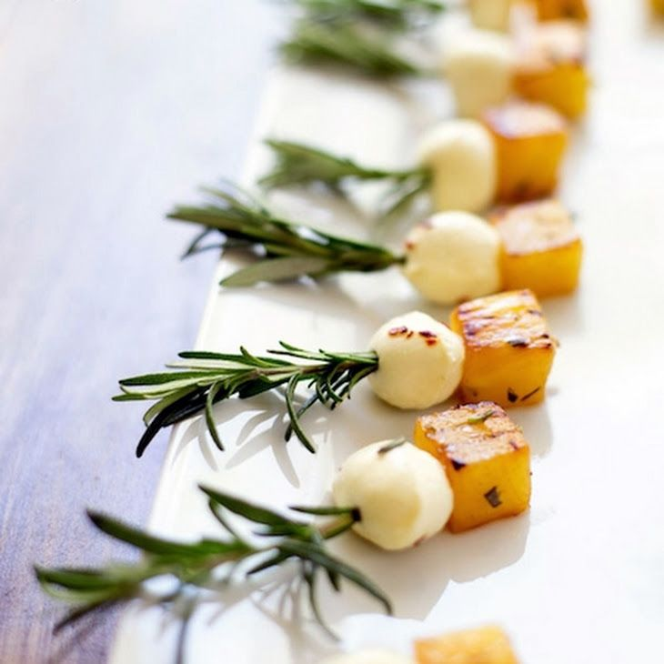 Rosemary Pineapple Mozzarella Bites Recipe with olive oil, rosemary, mini bocconcini, red pepper flakes, pineapple, rosemary sprigs