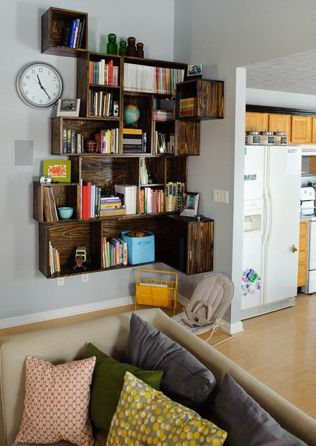 Def make this fabulous custom corner shelving... with wine crates perhaps?