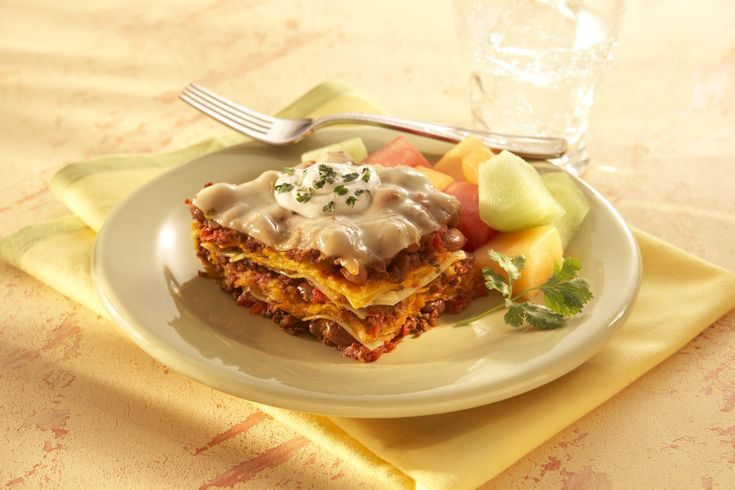 We've fused Italian and Mexican cuisine in this recipe for delicious tortilla lasagna. It makes a satisfying and tasty meal filled with layers of zesty chorizo sausage simmered with beans, tomatoes and melting Sargento® Ultra Thin® Pepper Jack Cheese Slices. You'll find every bite of this dish super cheesy.