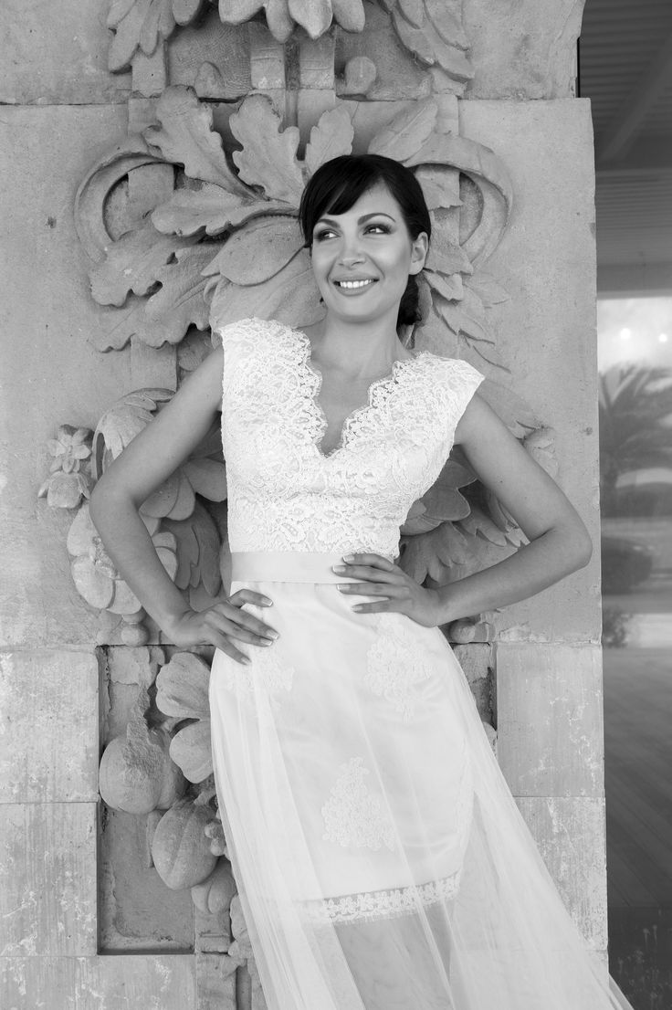 Beautiful Lace V neck wedding dress by Marianna Kastrinos.