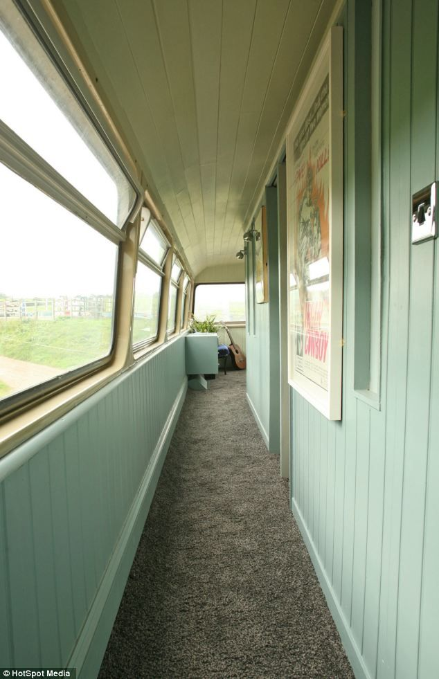 Big green bus: Double-decker transformed into caravan holiday home | Mail Online