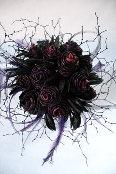 Wedding bouquet of purple flax flowers, with black twig and feather