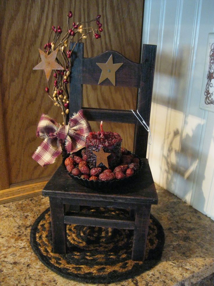 Prim Little Chair...with a candle & rusty stars.