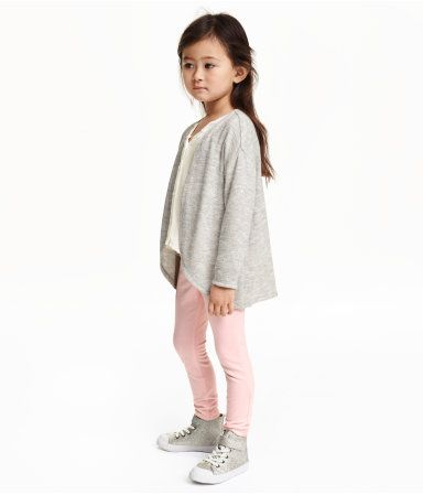 Melange cardigan in a soft, fine knit. No buttons. Rounded hem.