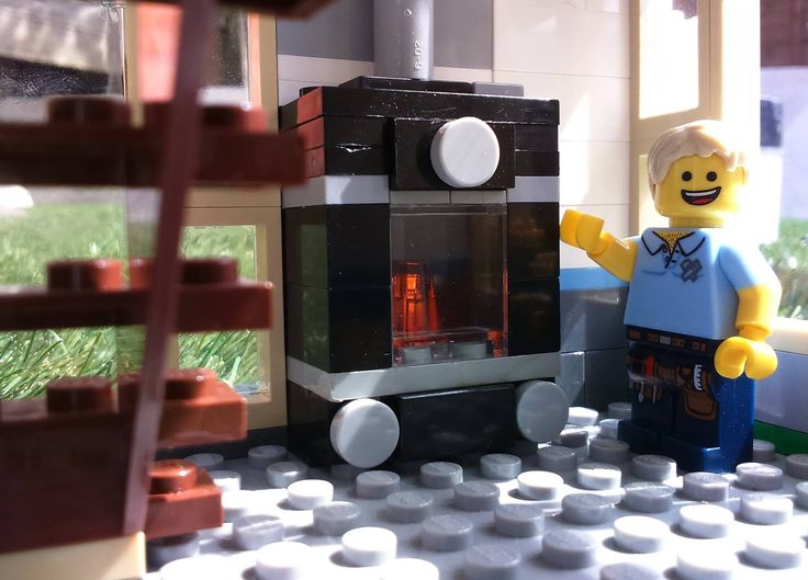 """With this picture, I began to move towards the quality of image that I had been looking for, where it feels like the characters are part of the """"real world"""".  The stove is installed in a Lego Family House."""