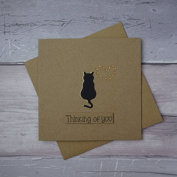 Unique cat sympathy card. Thinking of you card for the death of a pet cat.  This handmade with sympathy card for the loss of a cat uses recycled Kraft card and has a cat silhouette with gems in the shape of a heart. The colour of the shadow of the cat and the gems can be selected from the drop-down menu. The sentiment on this cat condolences card is added with 3D foam and reads: Thinking of you  PERSONALISING YOUR CARD: You can choose the colour of the matching shadow and gems used to make…
