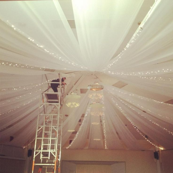 Ceiling canopy with string lights Venue dressing inspiration for we?