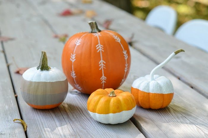 mod painted pumpkins - cute! I'm not a real pumpkin person but i do like these painted ones!!