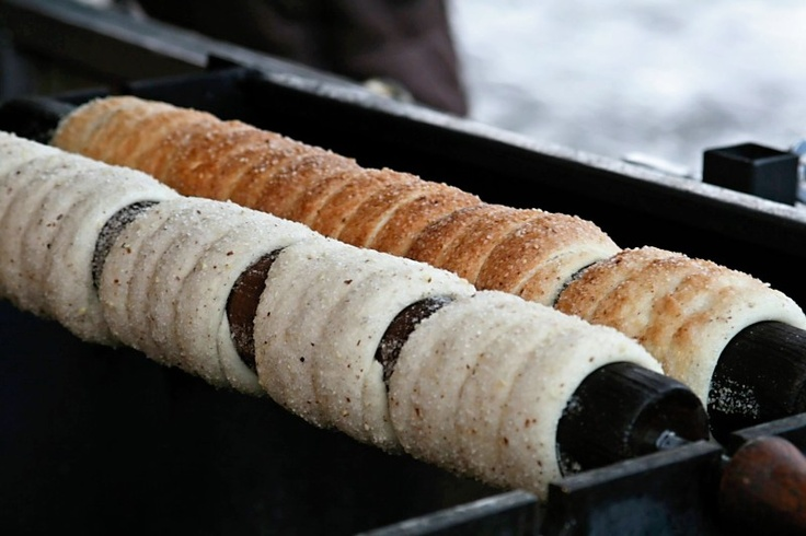 Trdelnik, a sweet treat found on  corners of the old town in Praha, is a bit like waffle dough -- cooked on a turning stick and grilled with sugar and almonds to create a sweet caramel crust. :) most delicious treat EVER!