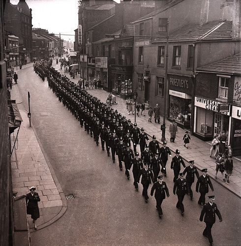Officers of Rochdale Borough Police march through the town on 14 April 1957 to celebrate the force's centenary. Services were held at two local churches after which the officers marched to the Town Hall. Rochdale Borough Police began life on the 28th of February 1857, one year after the County and Borough Police Act of 1856 made the provision of a police service compulsory in all areas. http://www.gmpmuseum.com