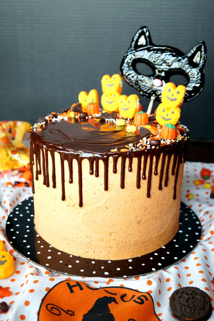 halloween cookies & cream cake; the worlds best rich, fluffy moist white cake (made with plenty of oil, butter, and even heavy cream) loaded with oreo crumbs; frosted in oreo crumb cream cheese buttercream; topped with creamy ganache