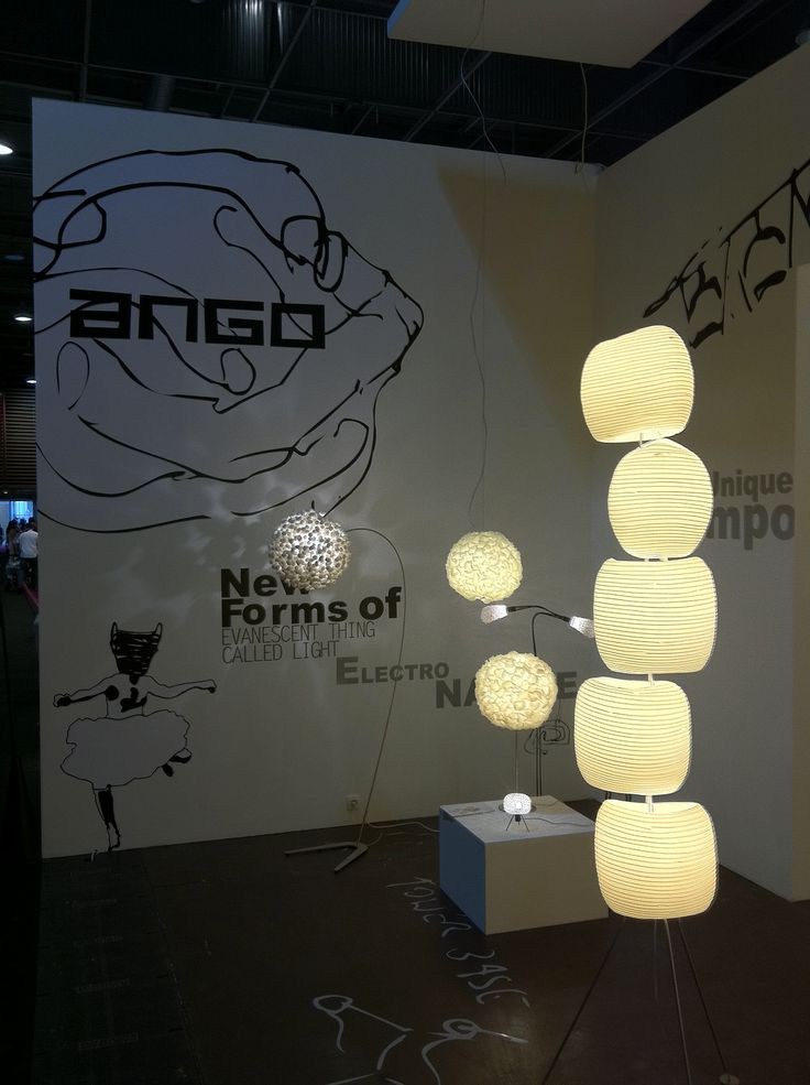 Picture from the exhibition at the Maison et Objet show in Paris. In front: 5 stone floor lamp (polymer foam tubes with inlayed rattan stripes) In back: Chrysalis sky floor lamp (stainless steel base with round lamp shade made of silk cocoons. www.udogangl.com