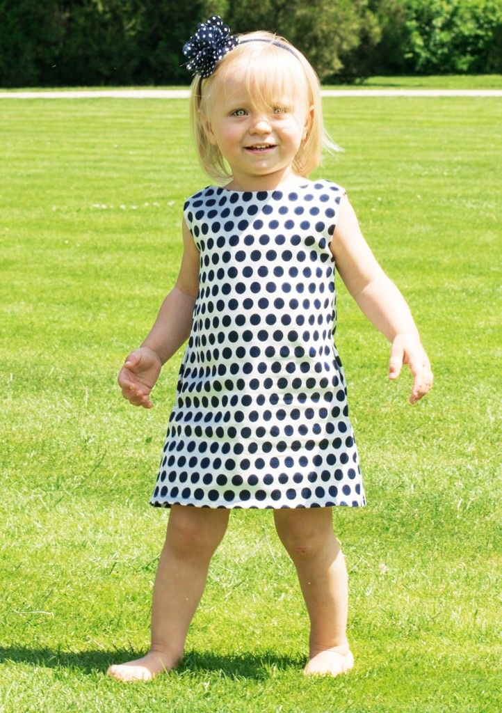 Short white dress with black polka dots. Made in Poland. What does it mean? High quality, environment-friendly production methods, oryginall style! #thesame #polkadot #dress #girl #kidsfashion #blackandwhite #elegant #littleprincess