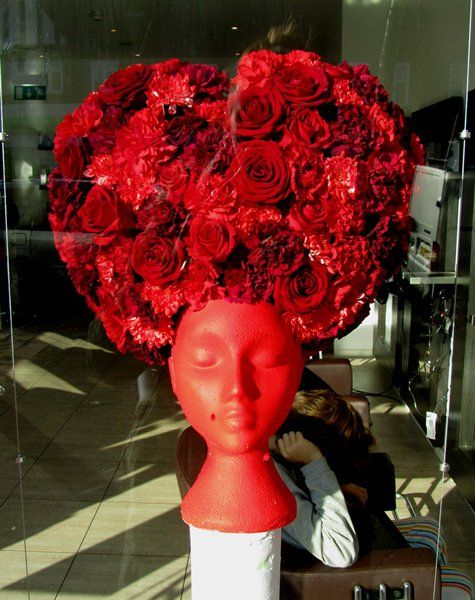 LOVE this! Valentines Day window display. Giant flower wig. Heart shaped hair. Flower sculpture. Valentines Day flowers. Floral Design by Boutique Blooms