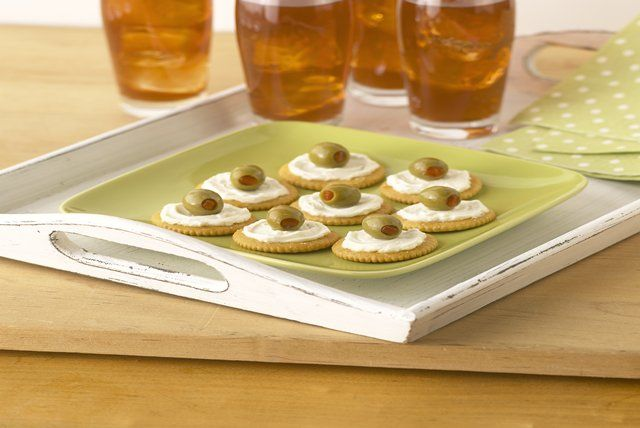 Pimento-stuffed olives, Neufchatel cheese and RITZ Crackers team up deliciously to make these Creamy Mediterranean Bites.