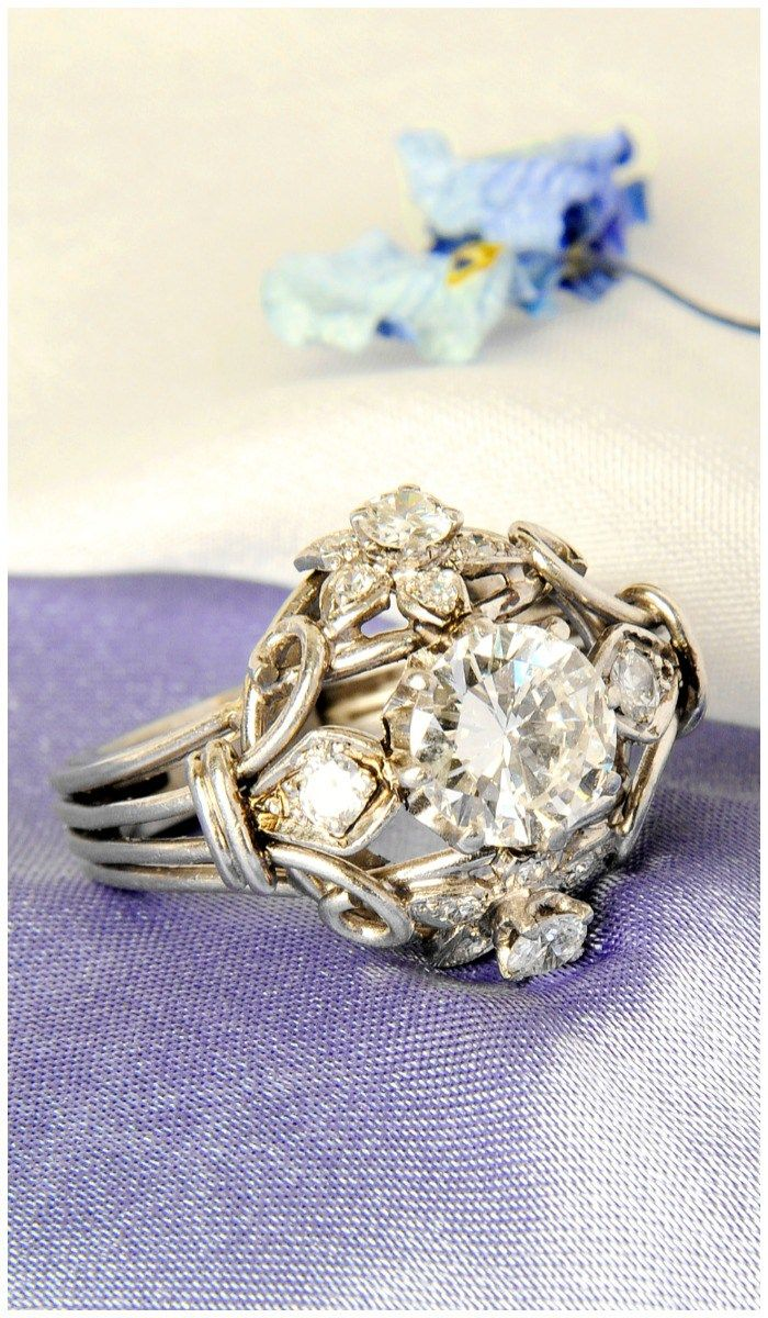 A fabulous vintage diamond ring! The center stone is 2.10 carats. Isn't it a cool design?