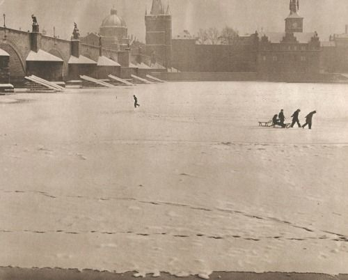 Winter Prague by J.Marco, late 40's, kids playing under Charles Bridge