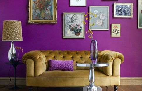 Golden sofa on purple backdrop