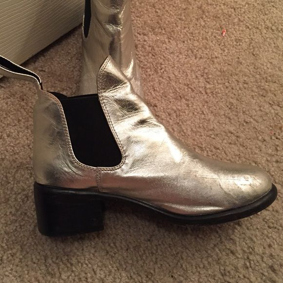Shiny silver ankle boots Gorgeous well loved boots!! They're incredibly durable and were my absolute favorite. Small minor scuffing at toes shown in photos and bending around ankles which is bound to happen during first wear. Retail for over $200, probably going to regret selling. Buy them before I change my mind Shoes
