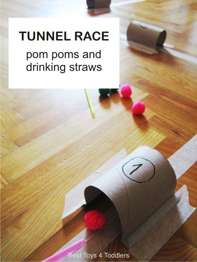 Simple game to play with toddlers at home - tunnel race with pom poms