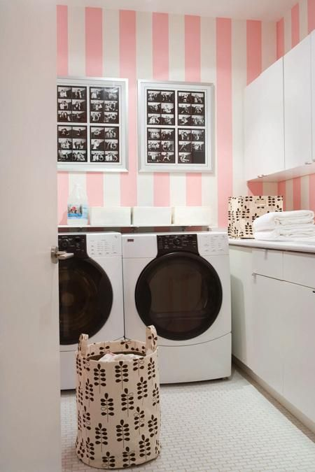 A sweet candy-striped laundry, love the black and white photos on the wall.