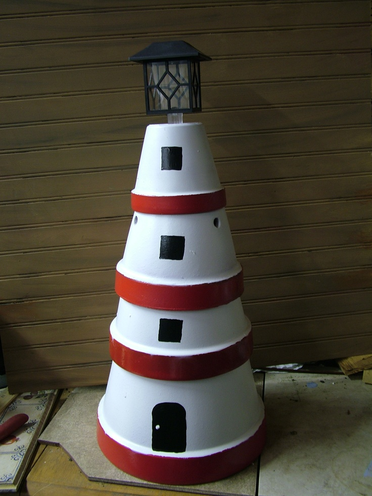 Lighthouse Made Out Of Flower Pots With Solar Light On Top