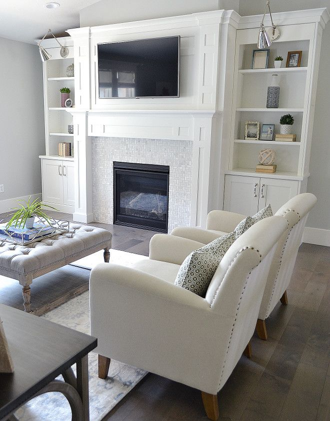 Built ins on either side of fireplace.