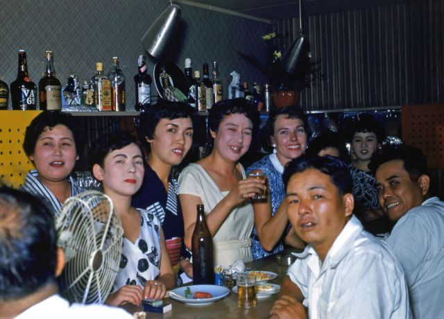 It is common in Japan that some bar they have hostesses serves you drink. These ladies put on make up and seems like whiter the better. 日本のバーにはホステスがいるところが有り飲み物をサーブしてくれる。化粧が白いのは白ければ白いほどいいということか。