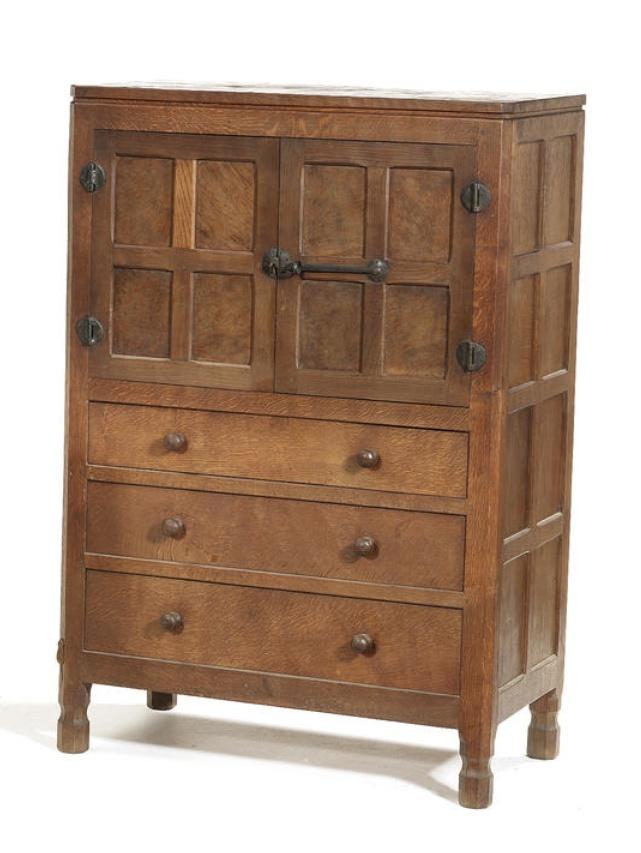 """Robert """"Mouseman"""" Thompson A Tallboy, circa 1940 oak and pollard oak, all over adzed surfaces, with a pair of panelled cupboards enclosing a single adjustable shelf, with wrought iron hinges and latch handle, above three drawers, raised on four octagonal supports 84cm long, 49cm wide, 127cm high, carved signature mouse"""