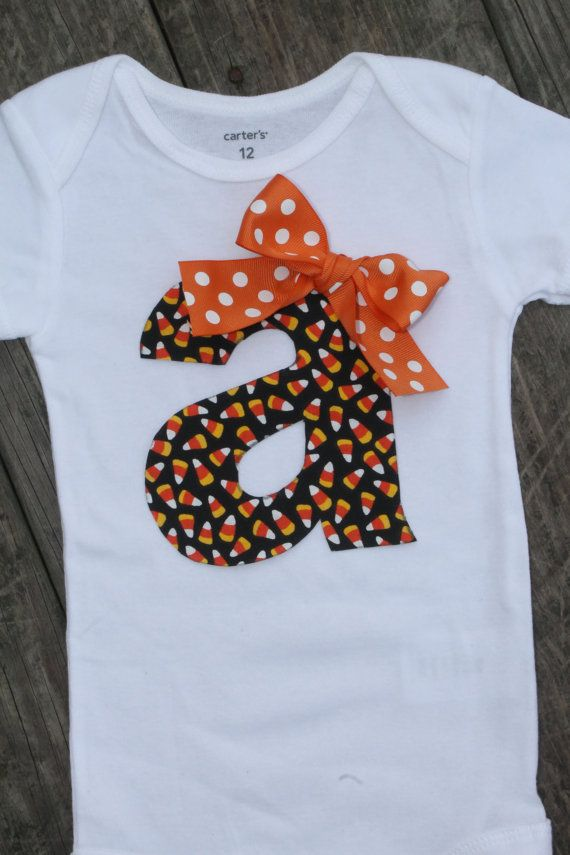 Halloween Onesie Candycorn Onesie Fall by SweetCarolineCrafts, $21.99...Would have to do it with her whole name since it's hard to monogram an o.