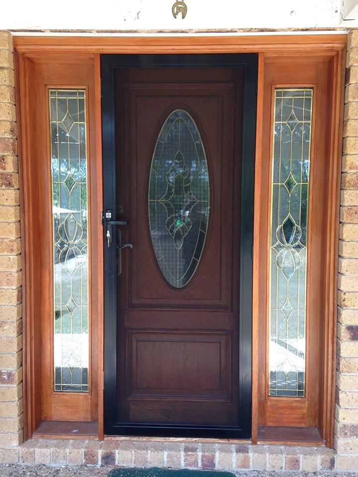 Australian Security Organisation P/L took this happy snap to show how the ForceField security door allows you to enjoy this feature door, while still keeping the home safe and sound. This door was installed at Yatala.