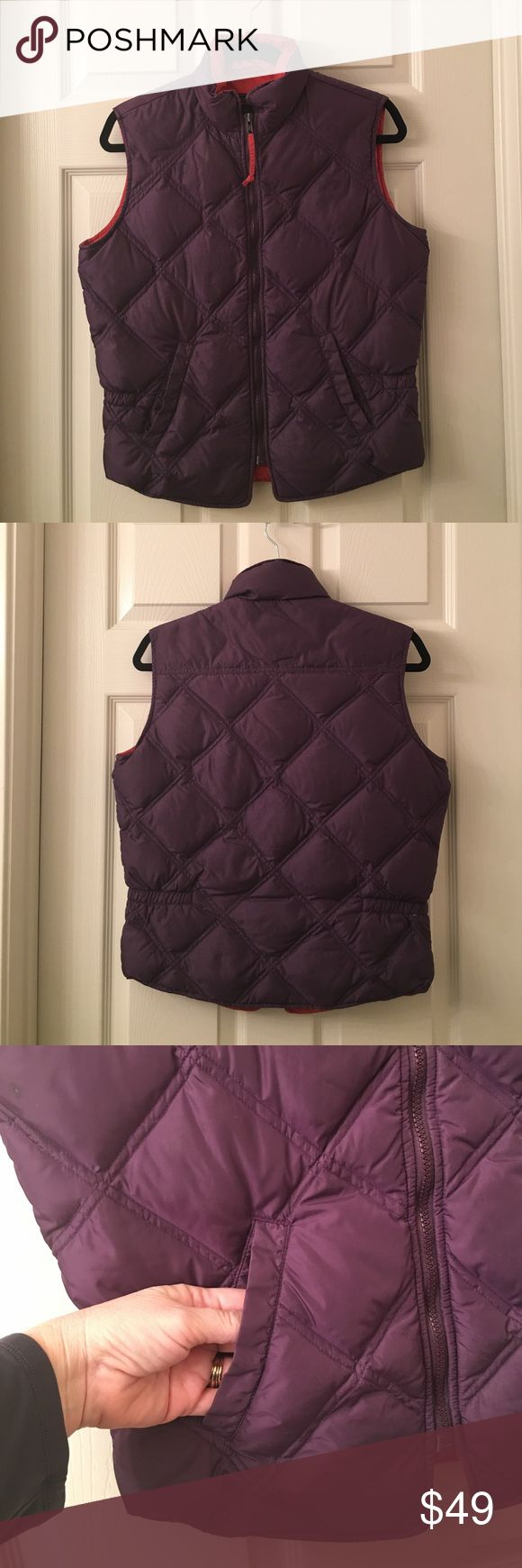 Ladies EDDIE BAUER Goose down puffy zipper vest S High quality EDDIE BAUER goose down vest to wear everyday with jeans❤this puffer vest is plum with orange lining, has a front zip and side pockets❤the sides have some elastic for a flattering fit❤sz S❤Good used condition💕❤️💕Happy poshing my friends💕❤️💕 Eddie Bauer Jackets & Coats Vests