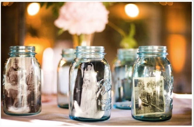 Photos in Mason Jars with flowers in them.  I would think that we should copy the pics because they might now make it...