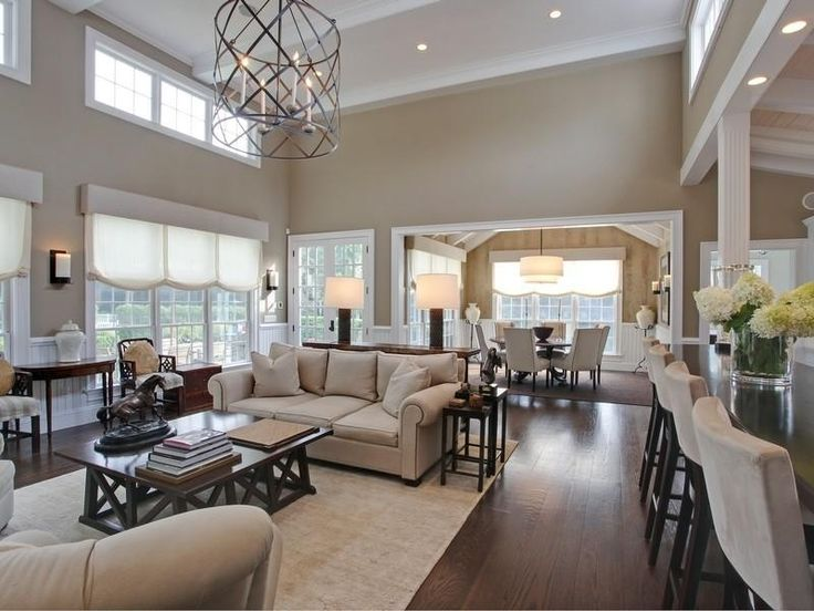 Contemporary Great Room With Wainscotting, Can Lights, Carpet, Columns, Wall  Sconce,