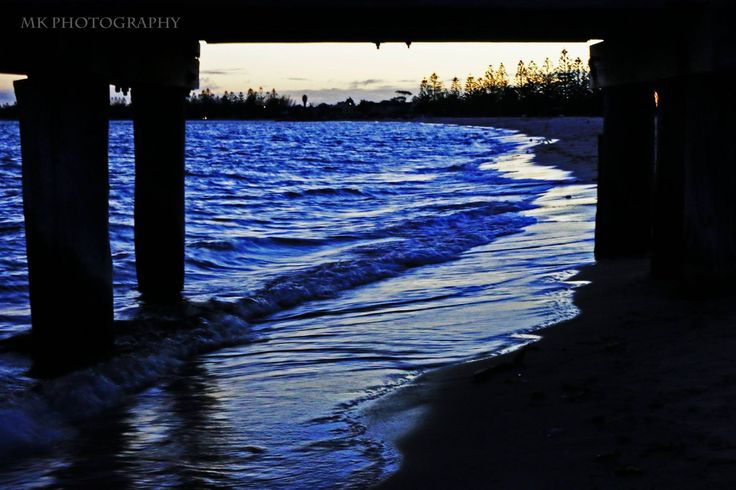 Winter by the water under the pier at Altona Beach in Victoria. Photo by MK Photography