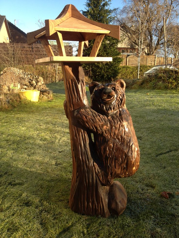 Chainsaw carved bear (Iain Chalmers) with oak bird table.