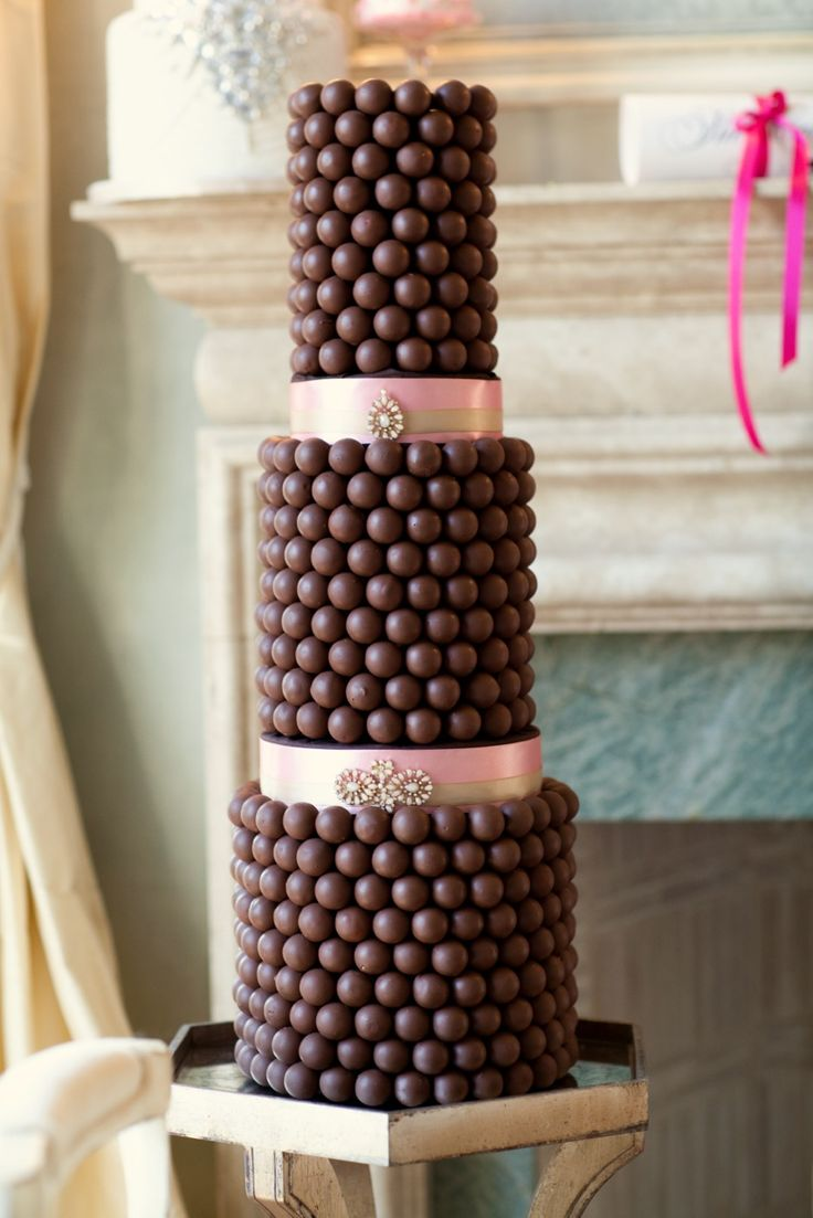 So much prettier than the profiterole towers! 3 tiered milk chocolate truffle cake with jeweled ribbon risers.  www.truffletruffle.com/sweetsupport.php