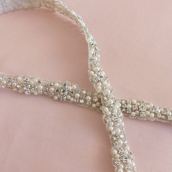 This is a very refined and elegant wedding belt. It is made with sparkling Swarovski crystals and beautiful miniature pearls all sewn onto a
