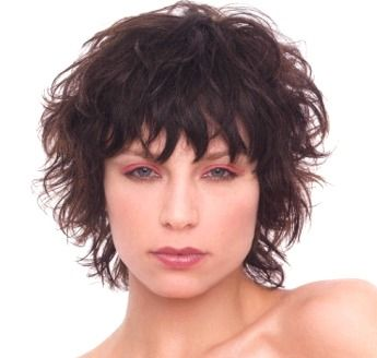 Short wispy & layered hair style with pixie bangs, brunette