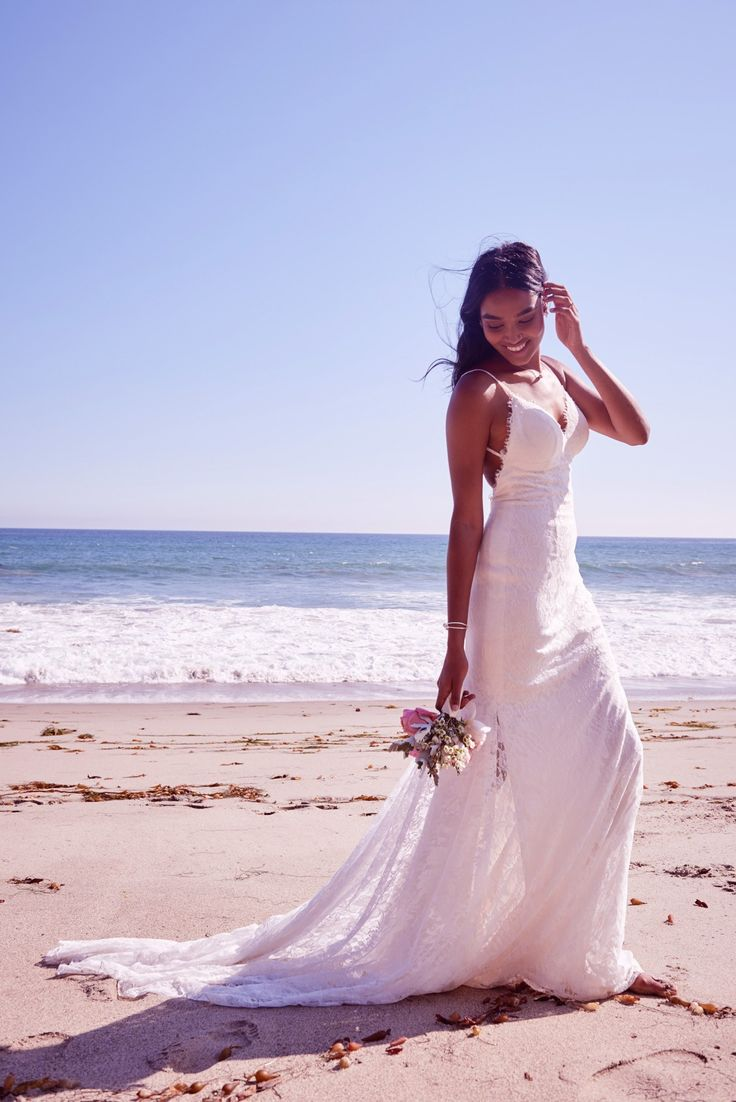 This form fitting and figure flattering eyelash lace sheath dress swoops low at the back, as a lace train trails weightlessly behind. It was as if it were made for a wedding at the beach. Shop this Galina style exclusively at David's Bridal