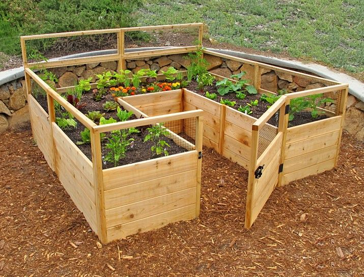 Raised bed with built in workspace for a gardener