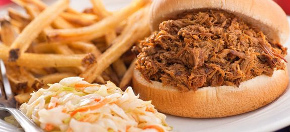 Learn how to make and amazing barbecue pulled pork with this easy recipe. Cooks right in the slow cooker with just a few easy steps and ingredients.