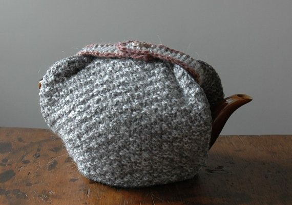 Grey woollen tea cosy with lilac trim and a vintage button from KororaCrafters via Etsy