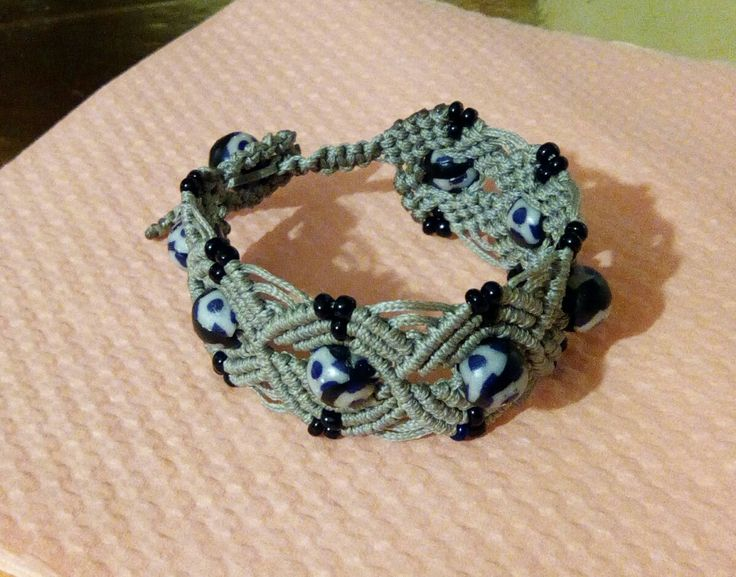 Macrame bracelet with handmade clay millefiori beads. Nice looking with a pair of jeans.