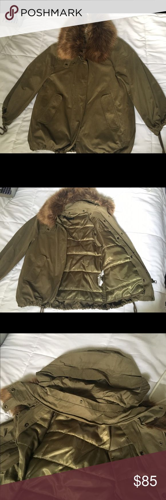 Zara Jacket NWOT Jacket with removable quilted lining. Bungees at the wrists and waist. Faux fur removable collar. Hidden hood made from the same fabric as body. Oversized fit, worn once Zara Jackets & Coats Utility Jackets