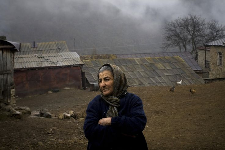 "Mirzoyan Nura in front of her house. She lost her son during the Karabakh war. ""There is nothing to tell, I just want peace, I want our kids to live in peace,"" she said. Nura is a neighbor of Ms. Hayrapetyan's grandmother Emma. Nagorno-Karabakh. Nov. 17, 2009."