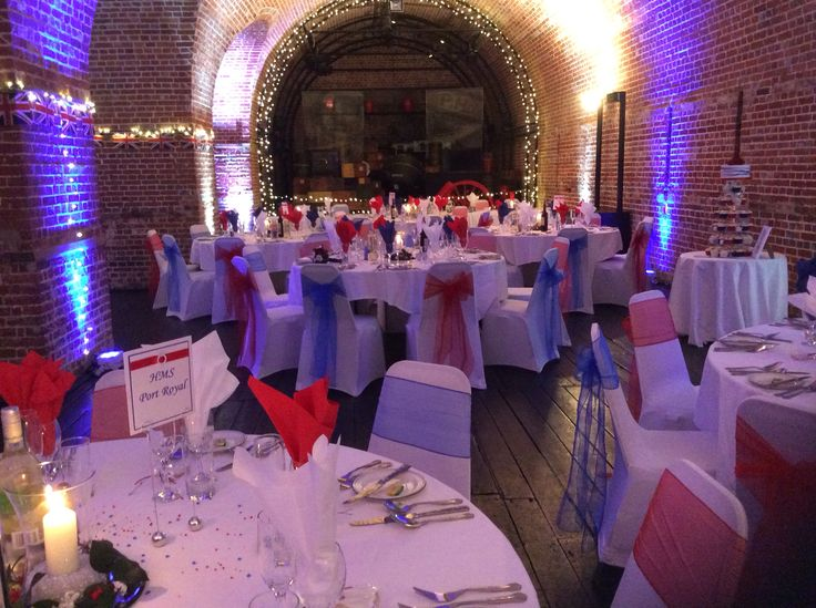 Beautiful wedding decorated by Weddings of Distinction and place settings by Bezani Catering @explosionmuseum