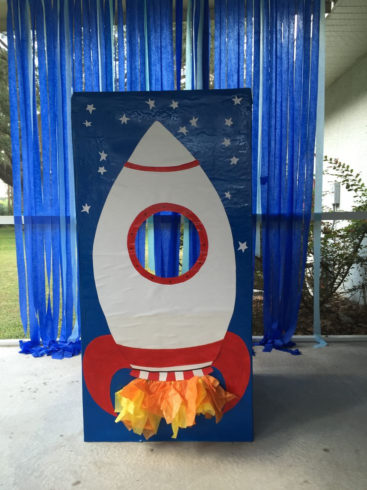 This DIY rocket photo booth was a huge hit! 1. We used insulation foam board to make a box (with the back side removed). 2. Then painted the whole box blue with spray paint. 3. Next was cut out white poster board for the rocket and trim out with red paint. Glue it to the box except for a few inches on the bottom. 4. Finally added tissue paper flames underneath and white paper stars in the sky. So cute!