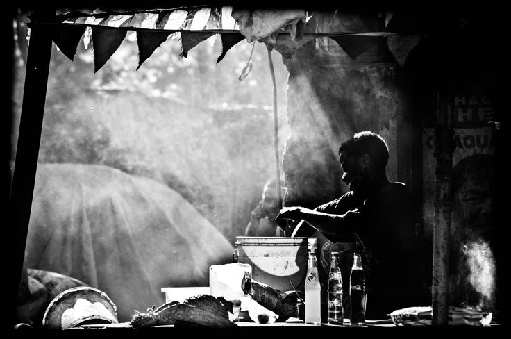 Cooking - at the Darajani market in Stone Town in Zanzibar. 2012.